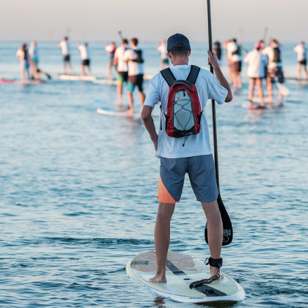 Man standing on stand up paddle board